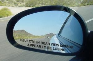 objects-in-rear-view-mirror-appear-to-be-losing